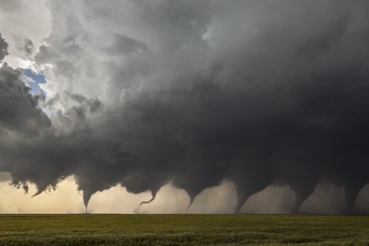 A composite of eight photos depicting the formation of a tornado.