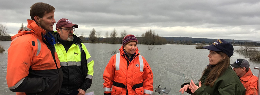 Acting NOAA Administrator Tim Gallaudet, left, with NOAA employees touring the Qwuloolt Estuary restoration field site in Marysville, Washington.