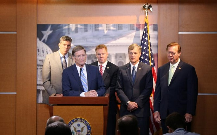 Lamar Smith at a press conference in summer 2016, accompanied by four other members of the House Science Committee.