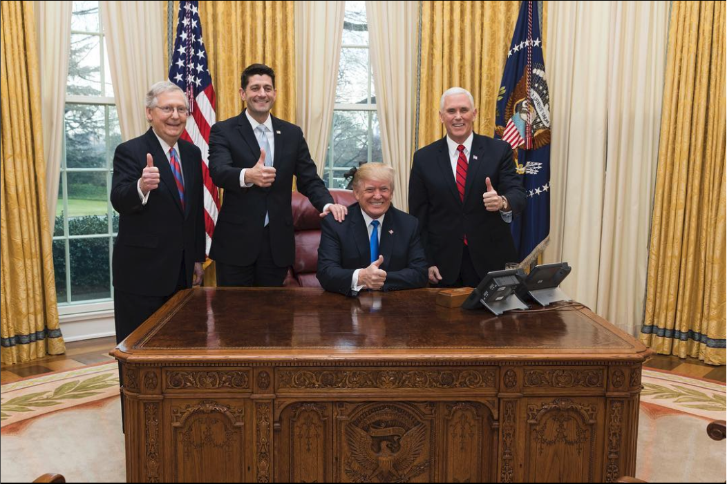Senate Majority Leader Mitch McConnell (R-KY), Speaker of the House Paul Ryan (R-WI), President Trump, and Vice President Mike Pence, celebrate the final passage of their tax reform legislation.