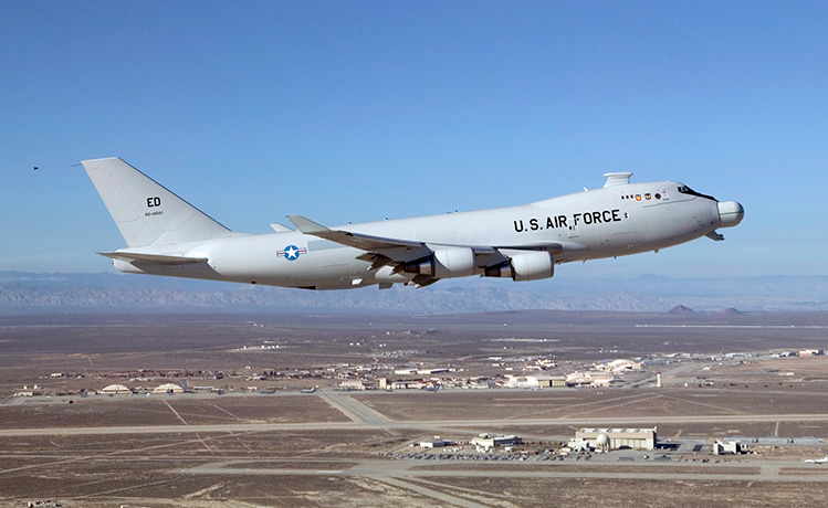 The U.S. Air Force's Airborne Laser Test Bed makes its final takeoff from Edwards Air Force Base on Feb. 14, 2012.