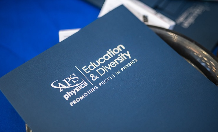"A folder reading ""APS Physics Education & Diversity: Promoting People in Physics"""