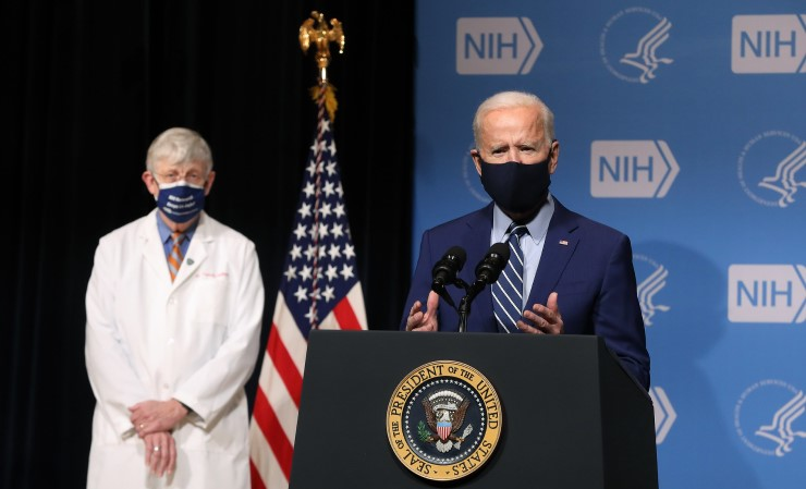 President Joe Biden delivering remarks alongside NIH Director Francis Collins during a visit to the National Institutes of Health in February.