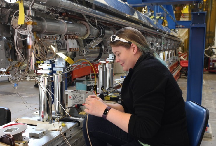 An engineer prepares a cryomodule at Jefferson Lab.