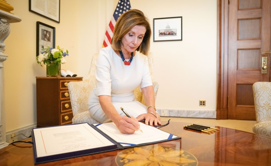 House Speaker Nancy Pelosi (D-CA) signs a stopgap measure on Sept. 27 to extend funding for federal agencies through Nov. 21. President Trump signed it into law later that day.