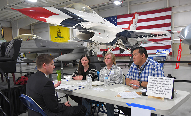 A candidate being interviewed at a 2019 science and engineering job fair at Hill Air Force Base in Utah.