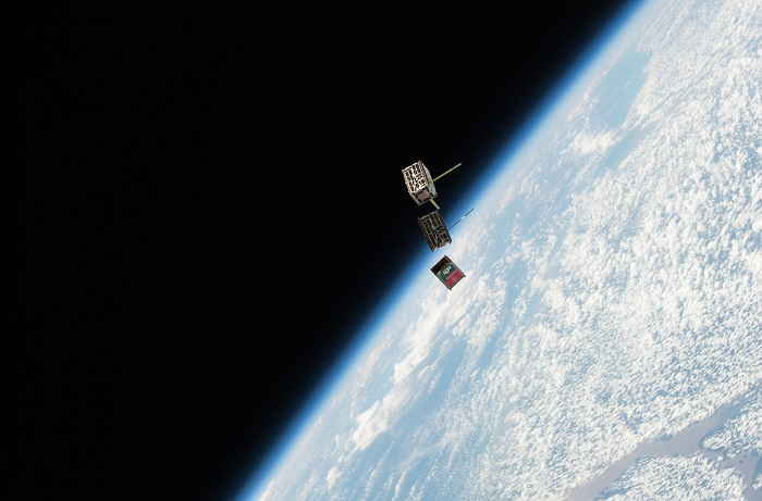 Three CubeSats being deployed from the International Space Station this past May. One of these was developed by a team at the St. Thomas More Cathedral School in Arlington, Va.