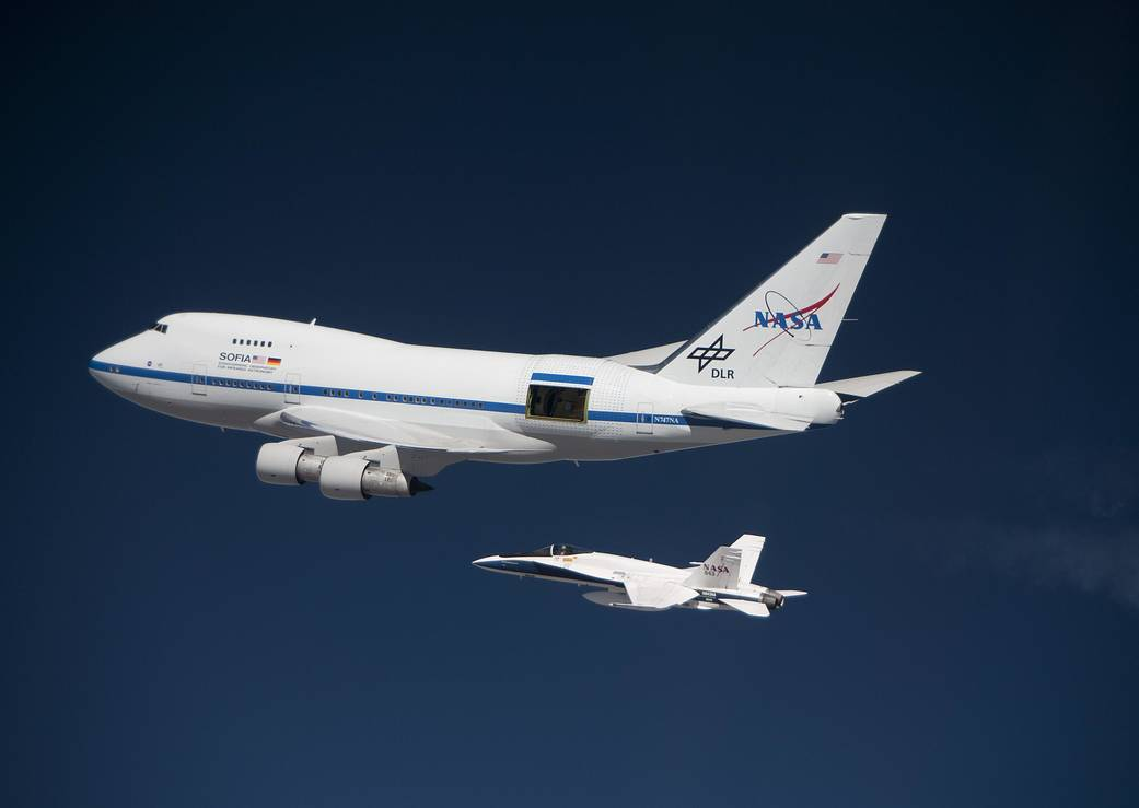 The SOFIA 747SP on a high-altitude test flight in 2010, accompanied by a NASA F/A 18 mission support aircraft.