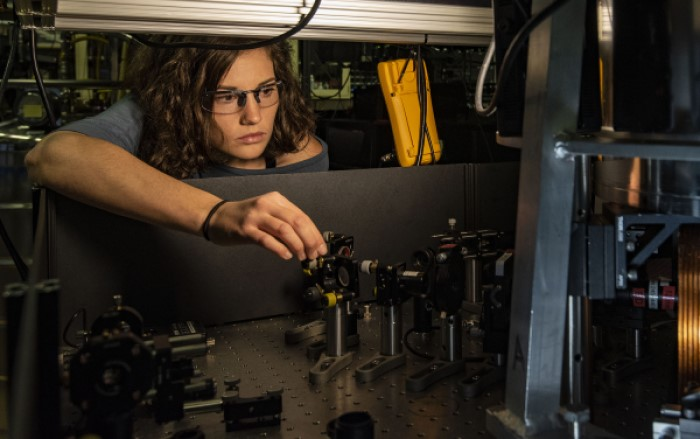 A NIST physicist steers a laser beam to perform novel measurements of a trapped beryllium ion, testing potential applications for quantum information processing.
