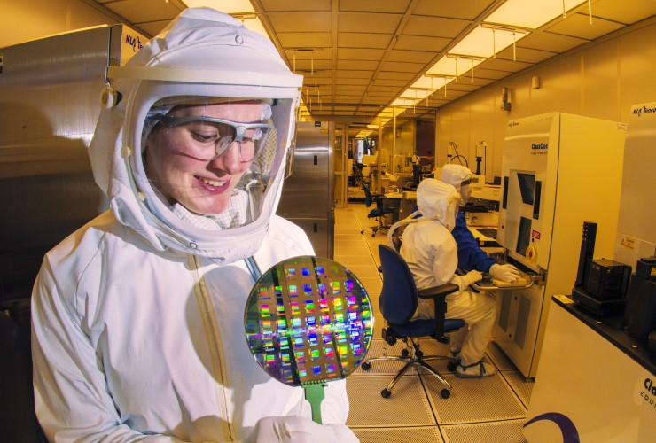 A scientist holds a silicon wafer