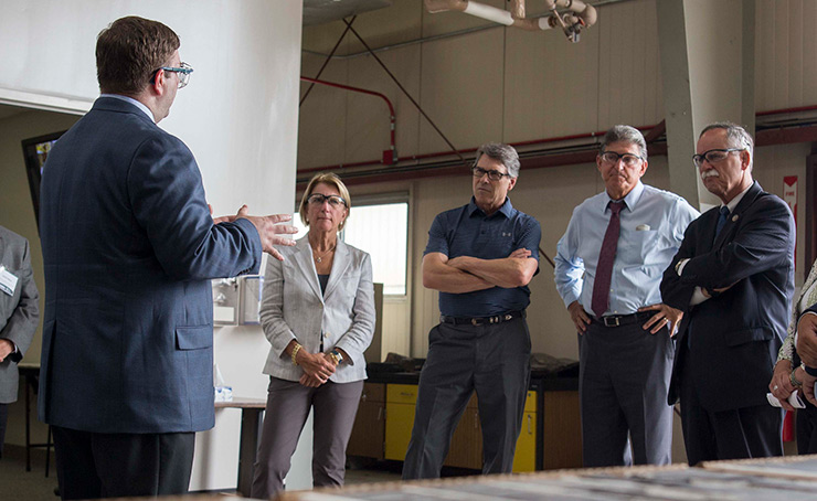 From left, Sen. Shelley Moore Capito (R-WV), Energy Secretary Rick Perry, Sen. Joe Manchin (D-WV), and Rep. David McKinley (R-WV) tour the Morgantown, West Virginia, branch of the National Energy Technology Laboratory.