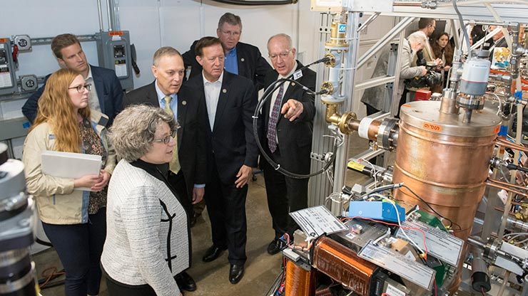 In this photo are, left to right: Science Committee Staff Director Emily Domenech, committee staff member Jimmy Ward, Fermilab project director Lia Merminga, and Reps. Andy Biggs (R-AZ), Randy Weber (R-TX), Frank Lucas (R-OK), and Bill Foster (D-IL).