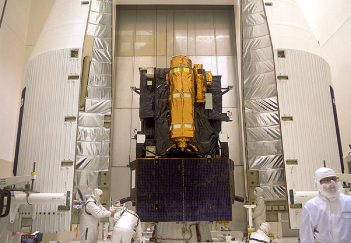 The Solar and Heliospheric Observatory in its payload fairing prior to launch in 1995.