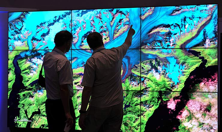 European space scientists view NASA data visualizations at the U.S. Center at the 18th Session of the Conference of the Parties to the UN Framework Convention on Climate Change, held in 2012 in Doha, Qatar.