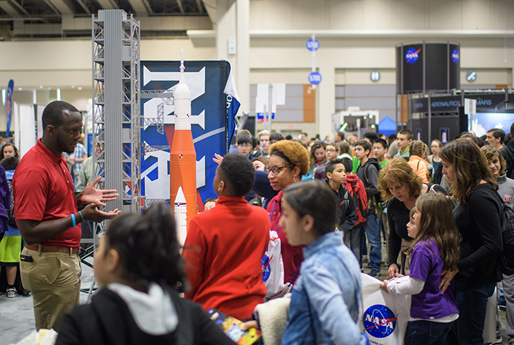 Attendees visit NASA exhibits during the 2018 USA Science and Engineering Festival in Washington, D.C.