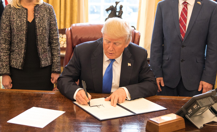 President Trump signing an executive order in January 2018.