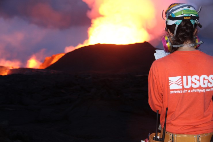 A USGS geologist from the Hawaiian Volcano Observatory monitors the 2018 eruption of Mount Kilauea.