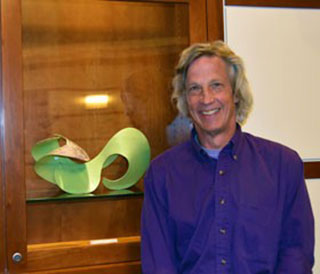 "Tom Osgood, sculptor, with his work ""Green Glide."""