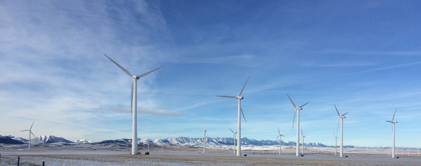 Wind turbines close to the Rocky Mountains