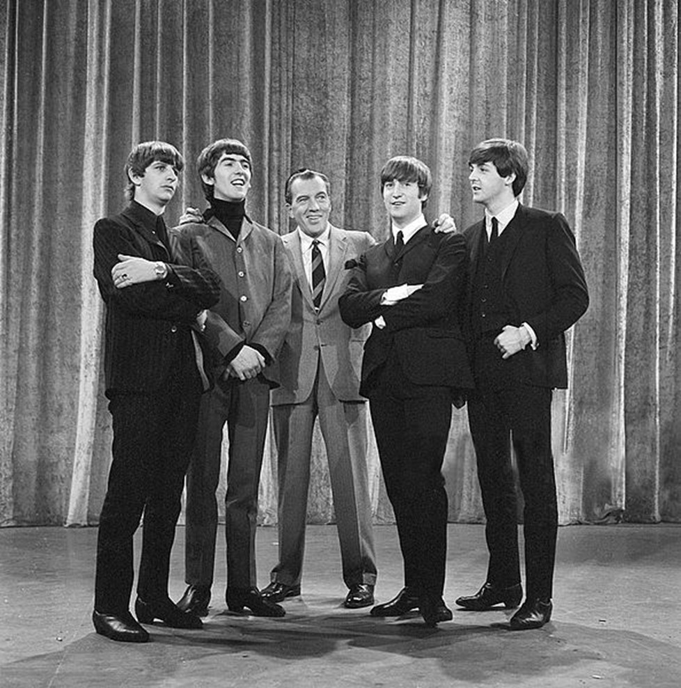 The Beatles stand with Ed Sullivan