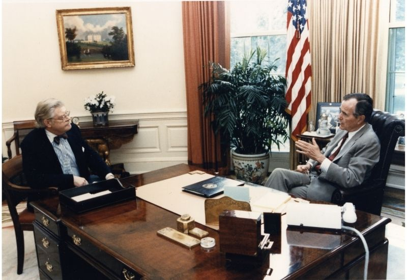 David Allan Bromley talks with President George H. W. Bush.