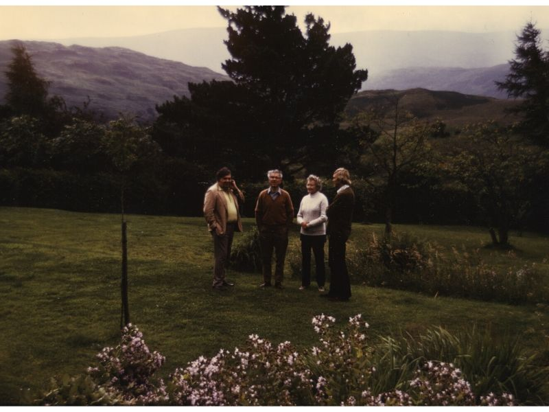 Geoffrey Burbidge, Fred Hoyle, Margaret Burbidge, and Donald Clayton in the garden at Hoyle's home