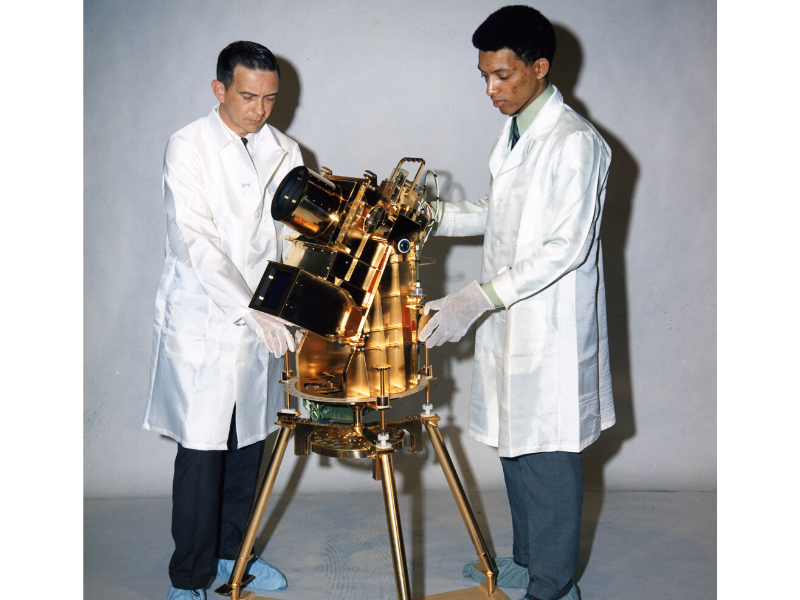 Project Engineer William Conway (left) and Principal Investigator Dr. George Carruthers (right) with the Apollo 16 Far Ultraviolet Camera/Spectrograph instrument.