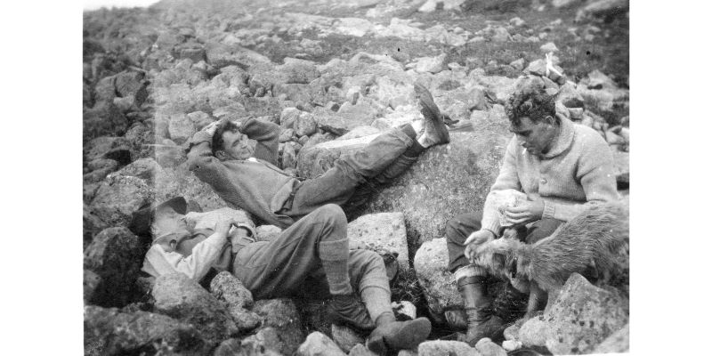 Dadourian, Bridgman and Davis rest while hiking.