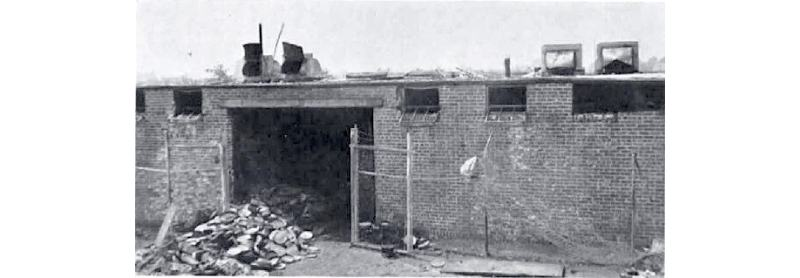 The 20th Century Fox film storage facility in Little Ferry, New Jersey after the vault fire on July 9, 1937. The film cans are being removed for silver reclamation.