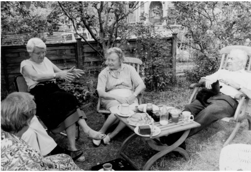 Vera Rubin, Margaret Burbidge, D. W. Sciama, and others gather at Judith Perry's home in Cambridge, England, 1990.
