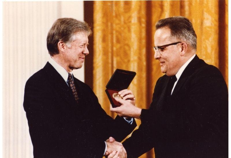 John Sinfelt shakes hands with President Jimmy Carter.