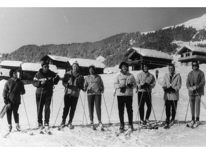 Val and Lia Telegdi pose with an unidentified group outdoors at a ski lodge in Verbier, Switzerland, in January 1960.