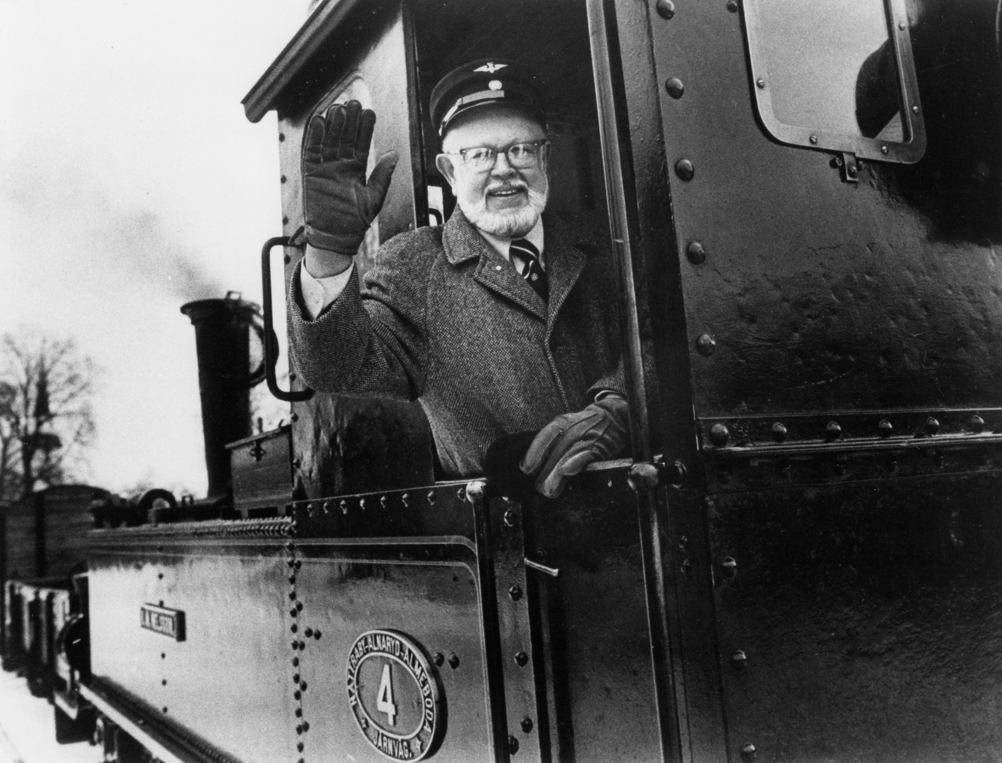 William A. Fowler waves from a train, 1983.