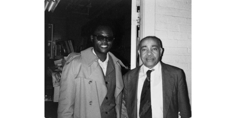 Photo of Warren Henry with a student.