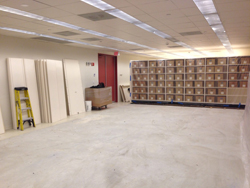 Half of archives taken down to bare concrete floors.