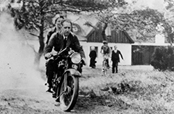 Niels and Margrethe Bohr riding a motorcycle