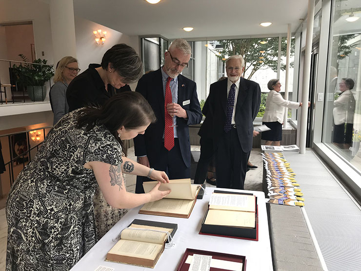Allison Rein shows a selection of Wenner Collection books to Lone Wisborg and our CEO, Michael Moloney, at the Danish Embassy.