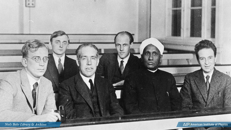 Group portrait of George Gamow, Charles Lauritsen, Niels Bohr, Ebbe Rasmussen, Chandrasekhara Venkata Raman, and Oskar Klein sitting at the Niels Bohr Institute, Copenhagen