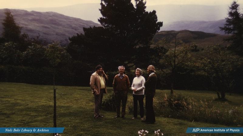 Geoffrey Burbidge, Fred Hoyle, Margaret Burbidge, and Donald Clayton in the garden