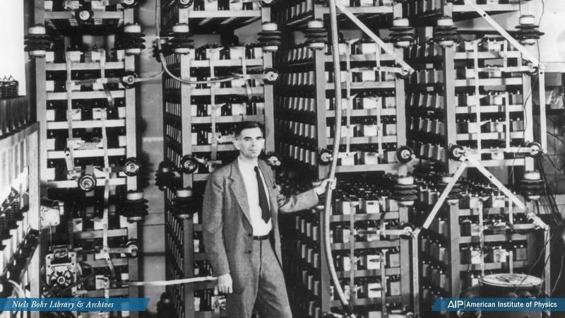 Horace Crane stands in front of equipment.