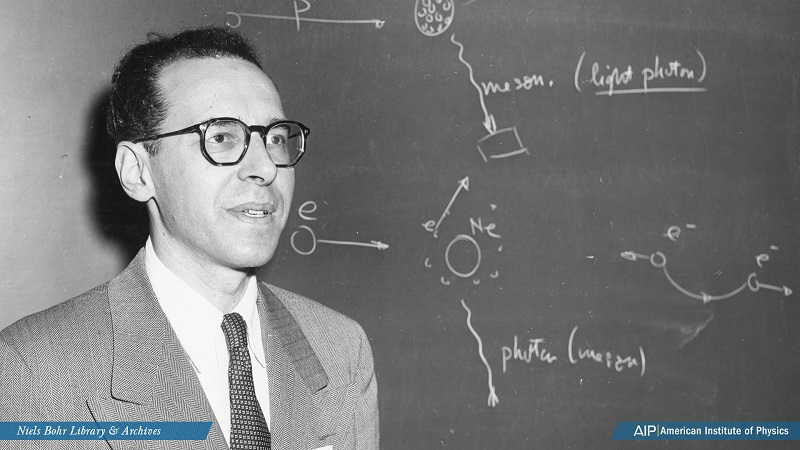 Maurice Goldhaber lectures next to a molecular diagram