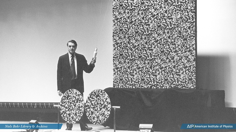 Edwin H. Land prepares to demonstrate an optical illusion before an audience in Shriver Hall, Johns Hopkins University, Baltimore, Maryland.