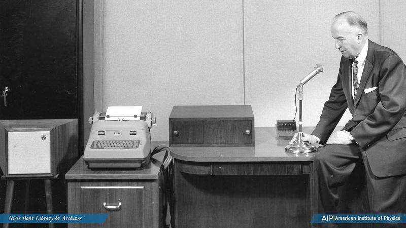 Engineer Harry Olson demonstrating a voice-operated speech synthesizer, typewriter, and language translator