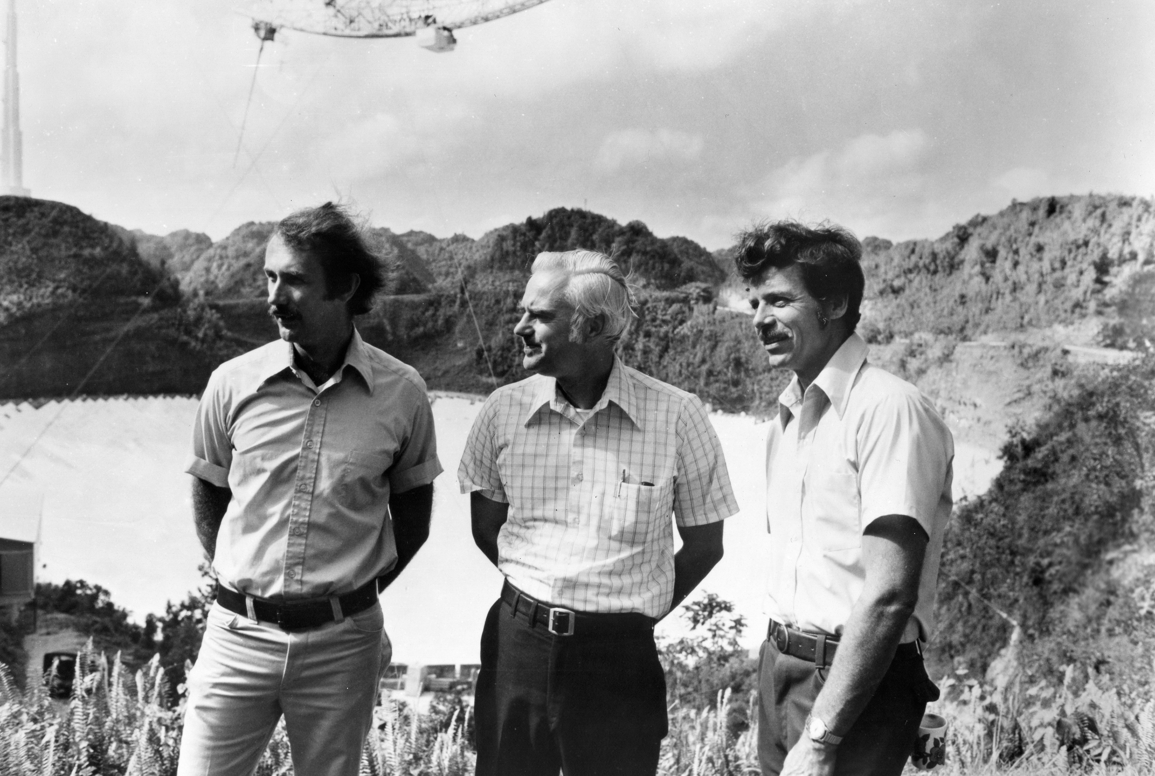 Harold Craft, Frank Drake, and Rolf Dyce stand outdoors.