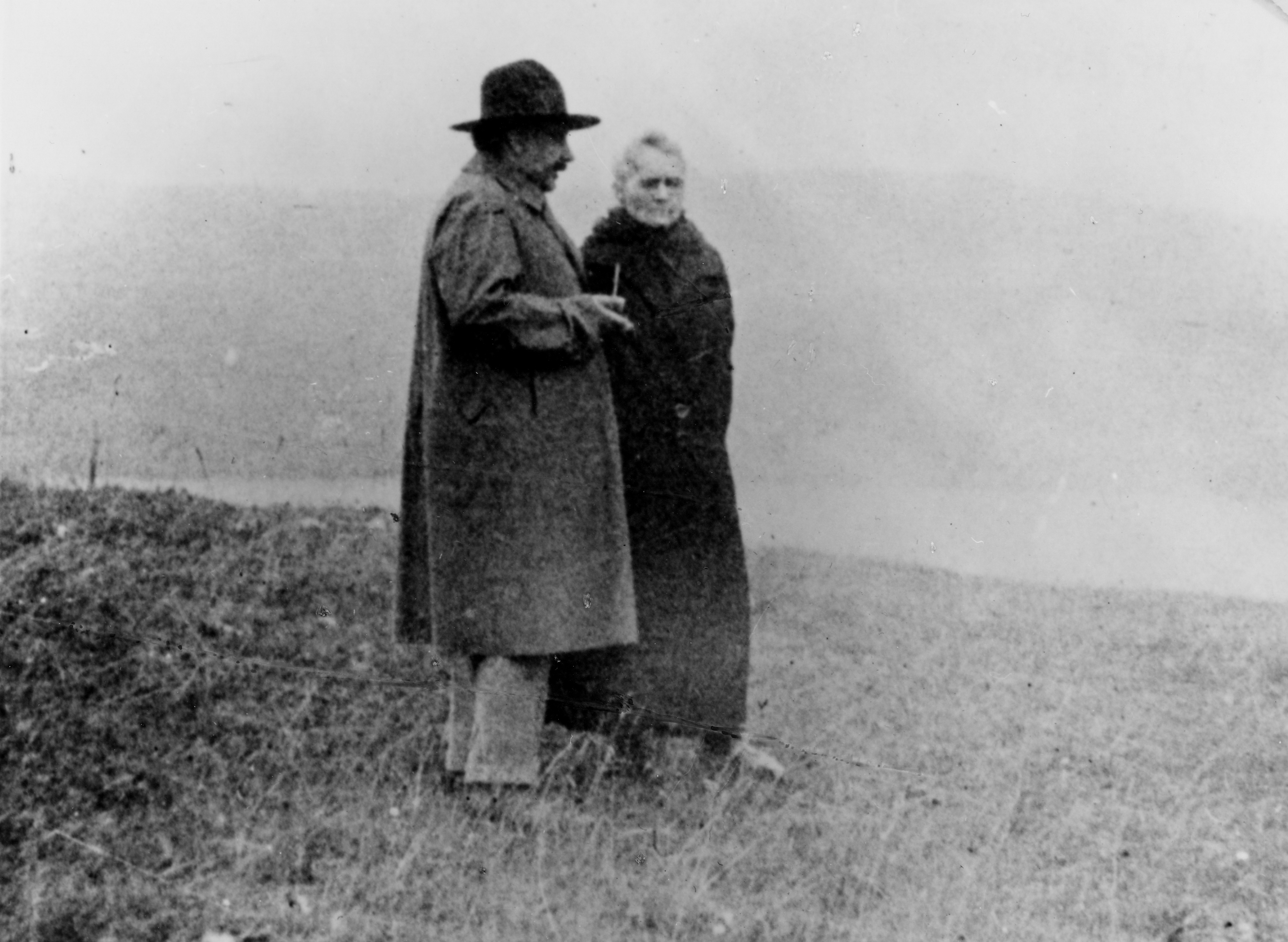 Albert Einstein (left) and Marie Curie (right) conversing by a lake in 1929