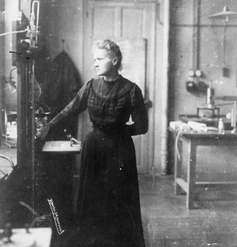 Marie Curie stands in her laboratory.