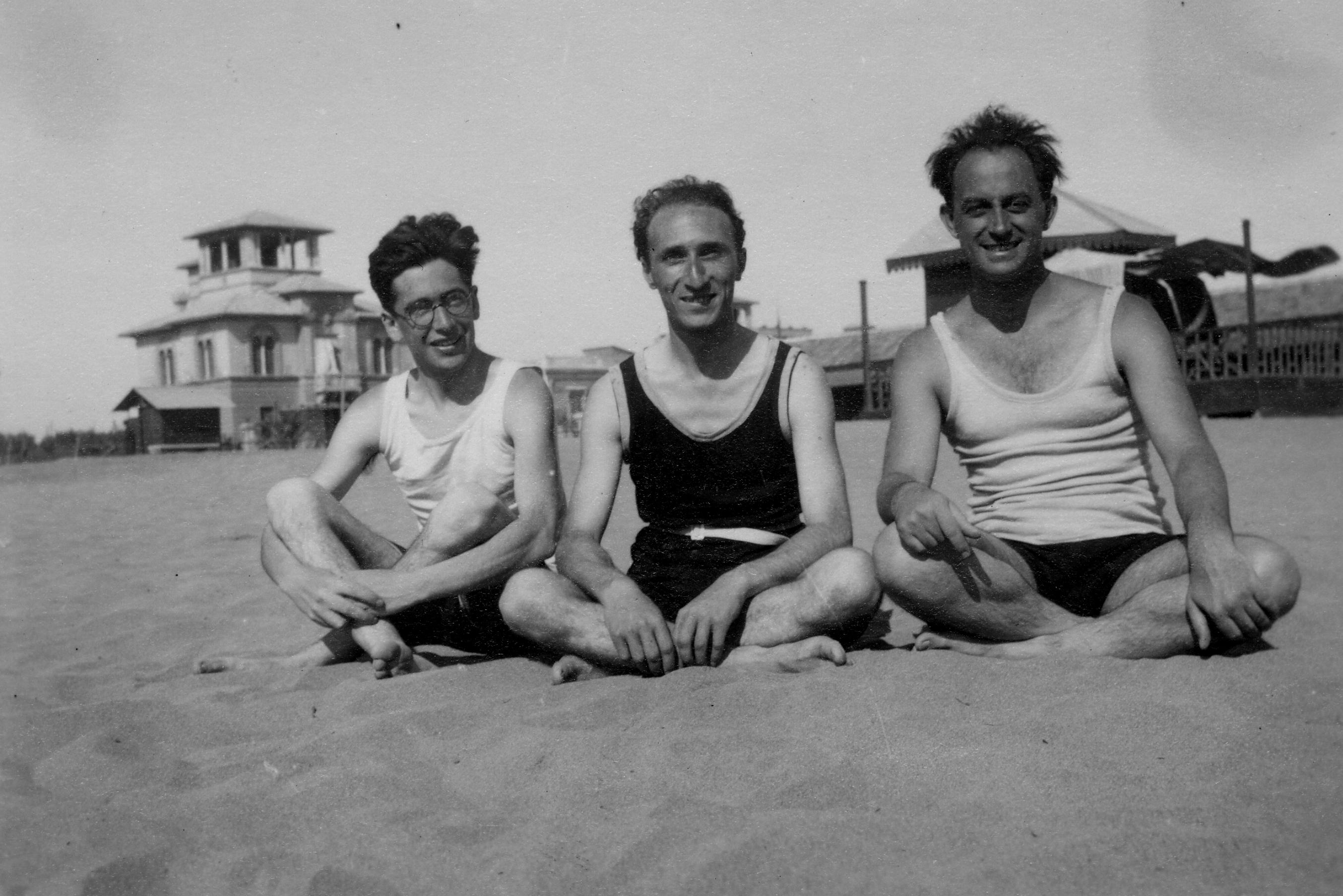 Emilio Segrè, Enrico Persico and Enrico Fermi sitting on beach