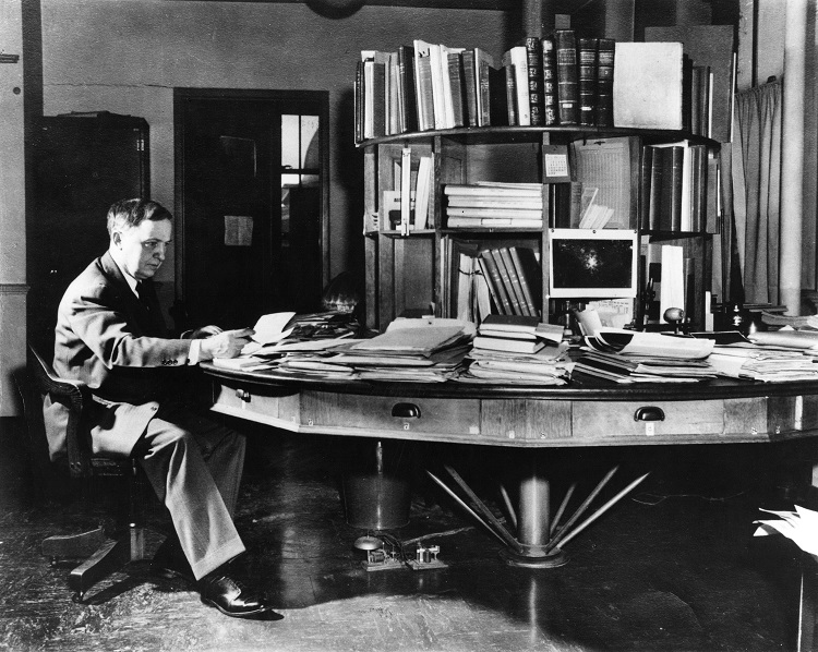 Harlow Shapley at his famous rotating desk at Harvard College Observatory