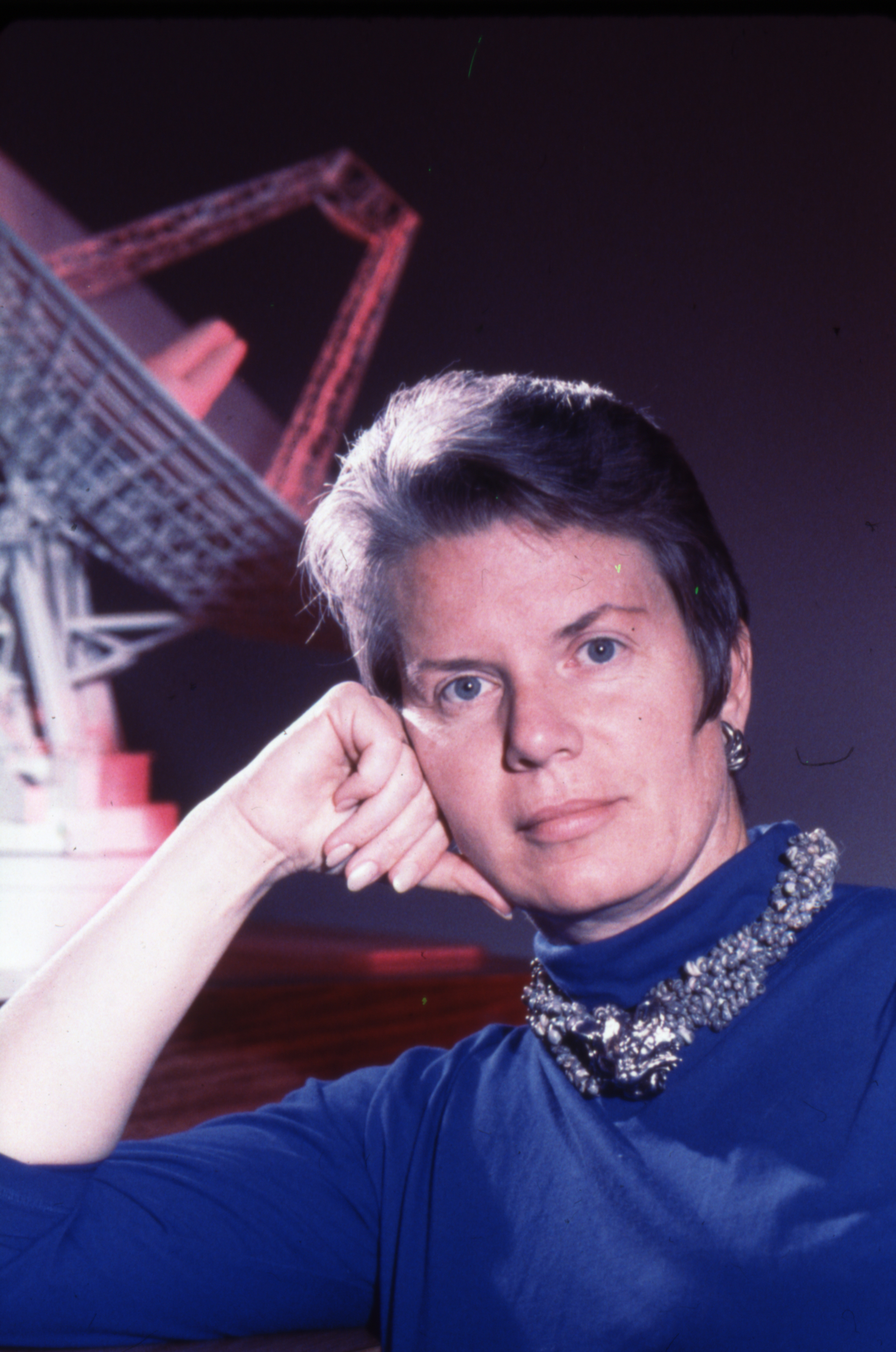 Portrait of Jill Tarter with a Radio Telescope Model