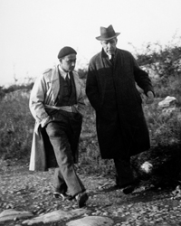 Enrico Fermi and Niels Bohr walking on the Appian Way, Italy.